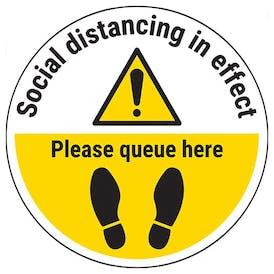 Social Distancing In Effect - Please Queue Here Temporary Floor Sticker