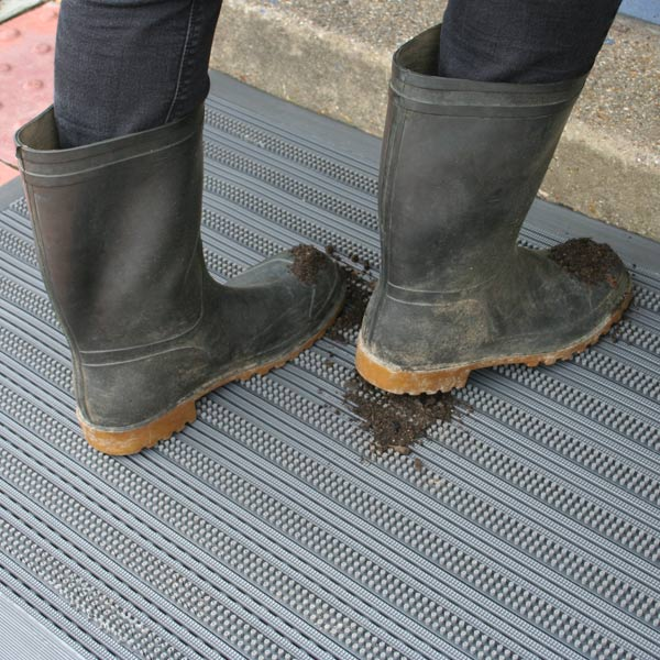 brush-scraper-with-muddy-boots.jpg